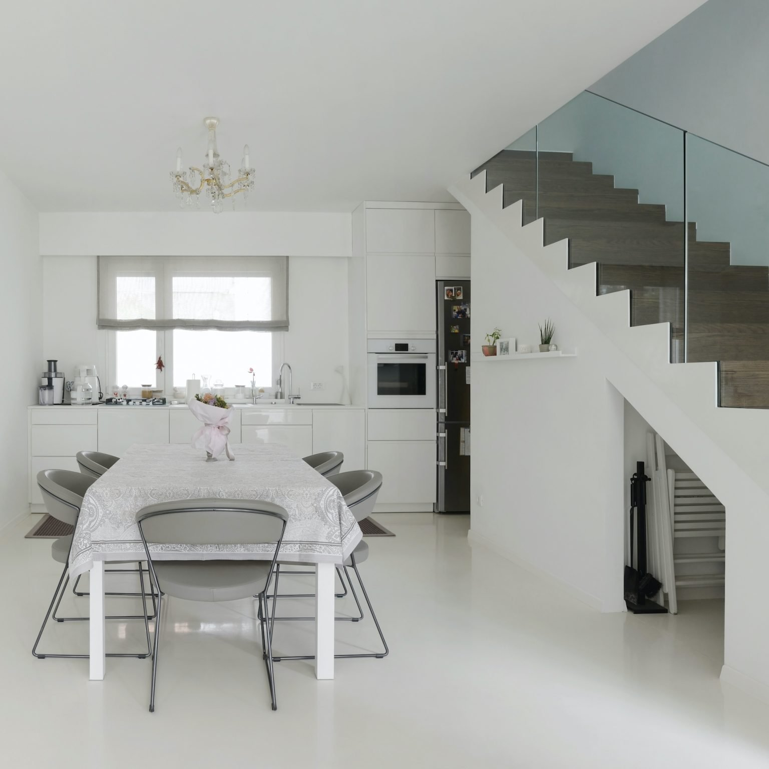 basement with glass balustrades to staircase