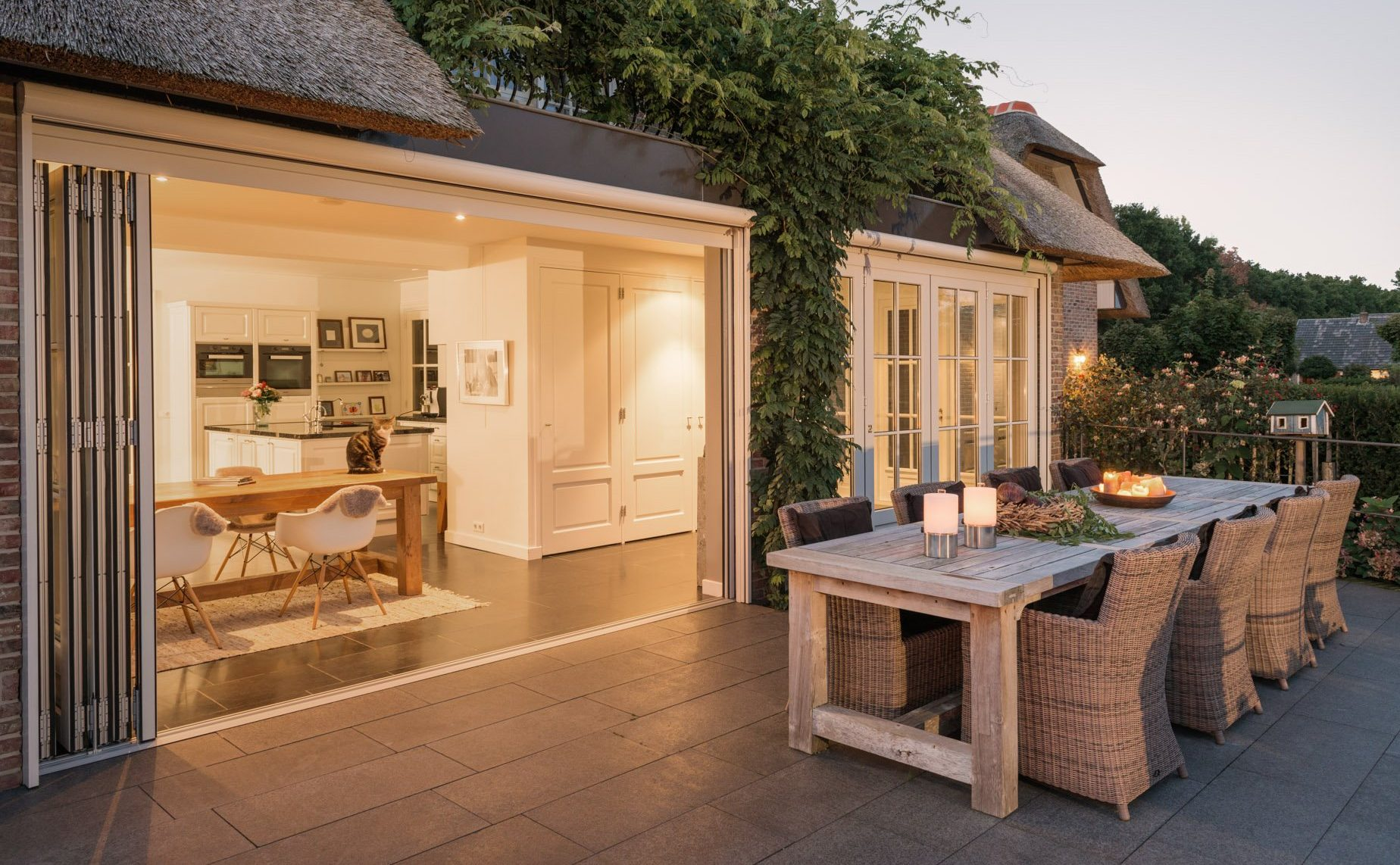 image of white bifolding doors in thatched cottage