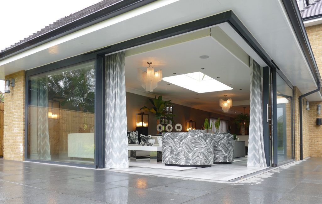 low or flush threshold for bifolding or sliding doors showing image of a corner set of patio doors