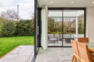 Low and flush thresholds for bifolding or sliding doors