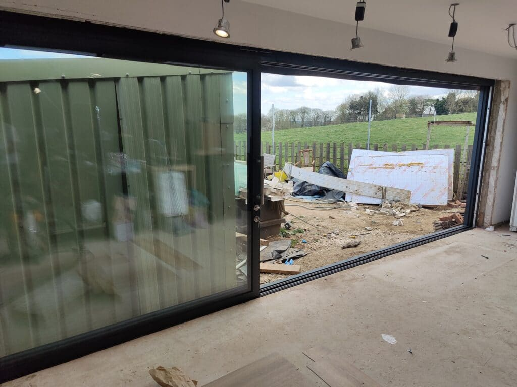grey patio doors fitted in a new extension