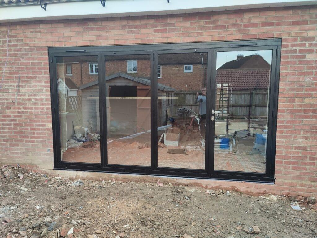 black origin bifold doors in East Leake new build home