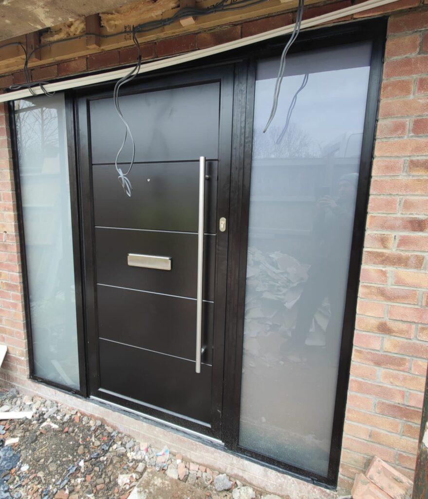black modern front door in a new build home