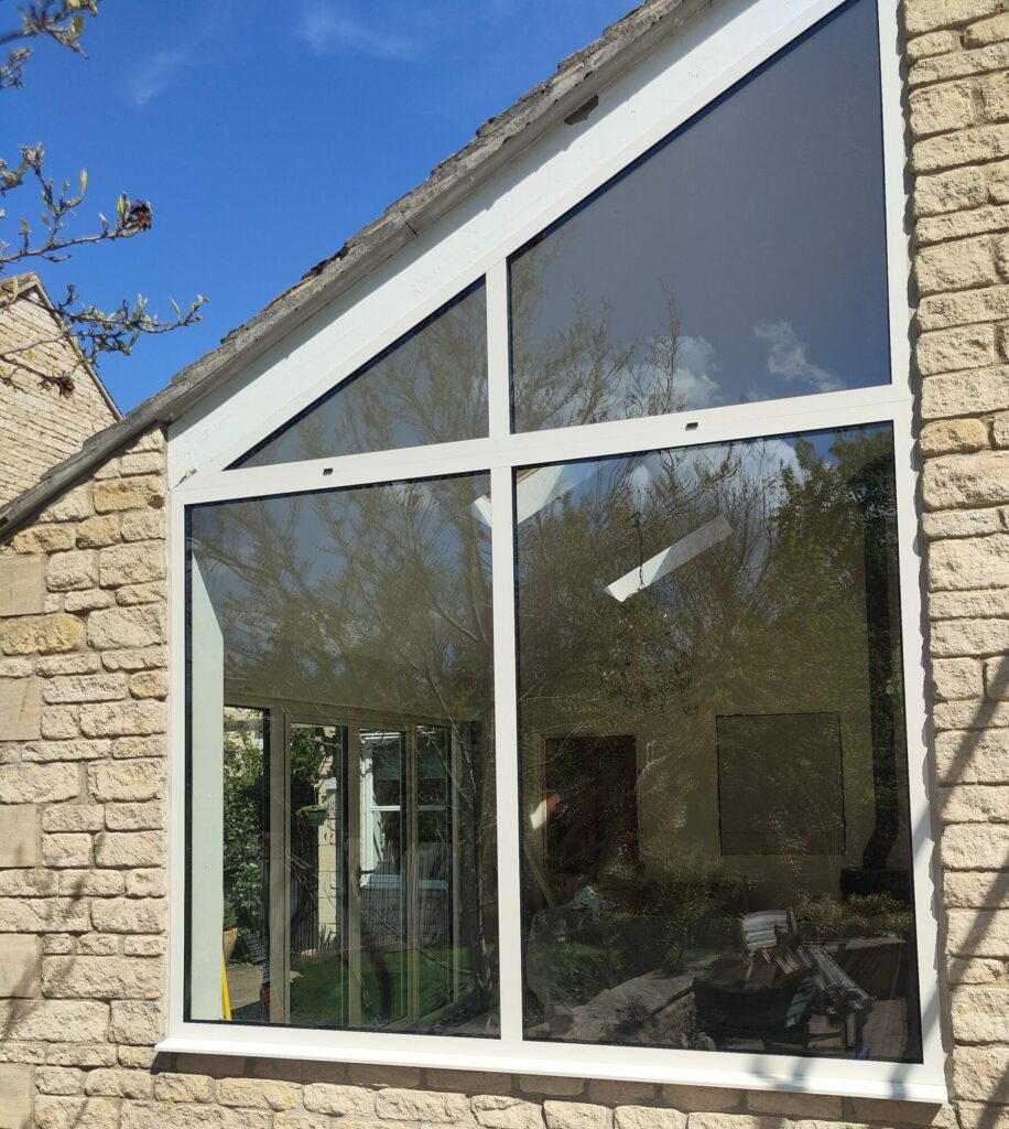white window beside aluminium French doors in Kings Cliffe house