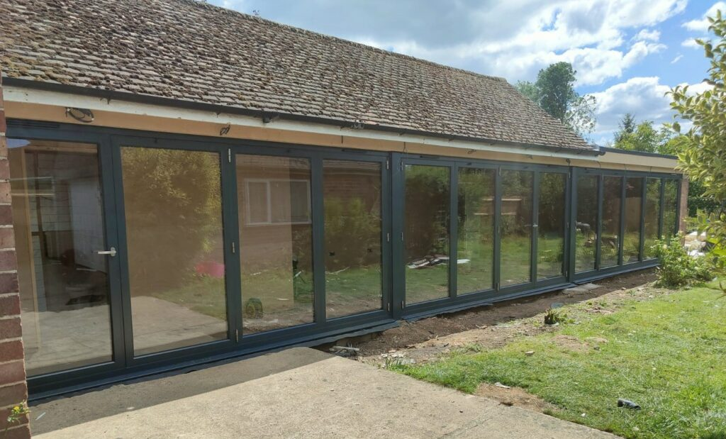 Origin bifold doors in Peterborough to a large extension in a black colour