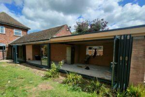 Origin bifold doors in Peterborough to a detached house with garden views